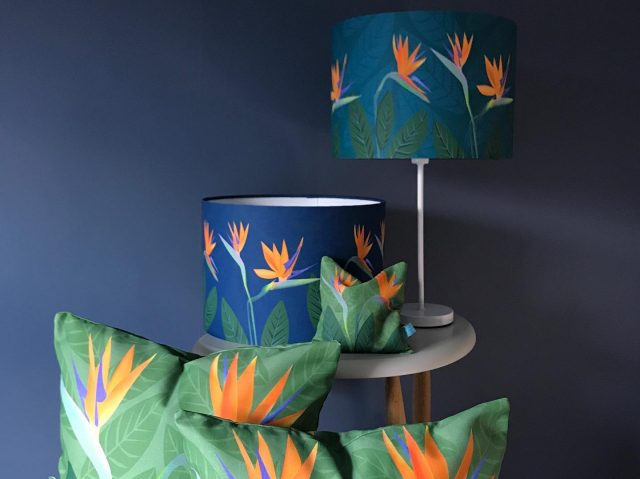 green and blue lampshades and cushions