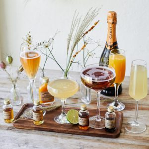 Buffalo Bar wide range of alcoholic drinks in glasses and bottles on wooden tray