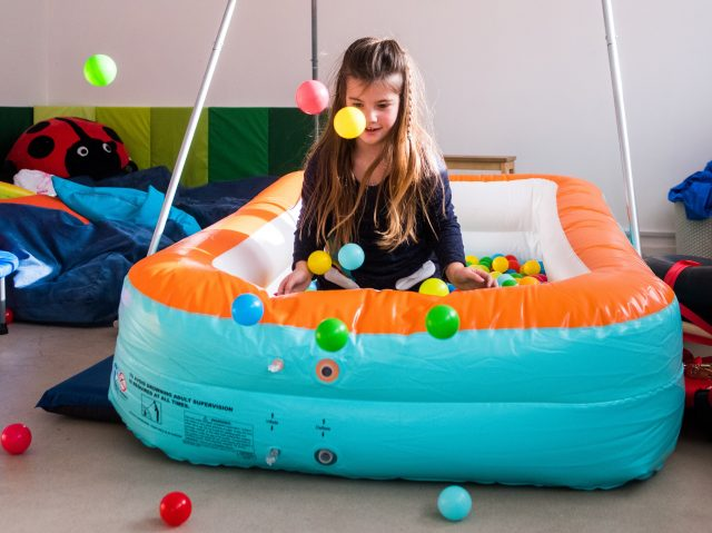 Young girl in ball pit