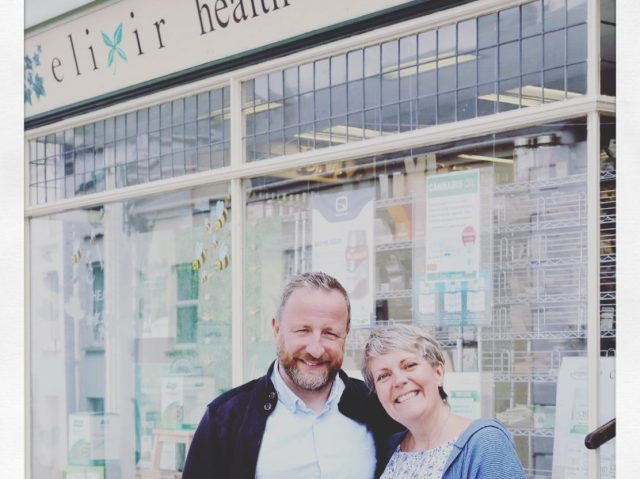 Man and woman stood outside elixir health foods